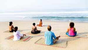 Healthy yoga class by the beach.