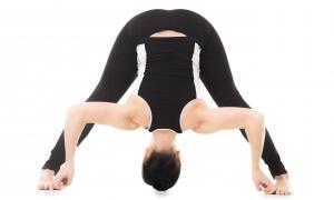 Sporty yoga girl doing fitness training, asana Wide-Legged Forward Bend, Prasarita Padottanasana posture, isolated on white background