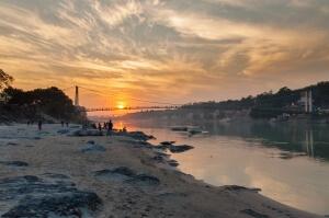 View of River Ganga and Ram Jhula bridge at sunset. Rishikesh. India
