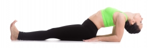 Beautiful sporty girl practices yoga, performing Matsyasana, fish pose, backbend exercise, yoga for relieving stress