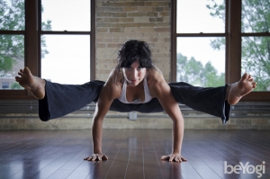 Woman in yoga pose at yoga teacher training