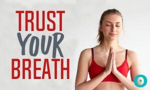 Yoga woman laughing in Namaste pose