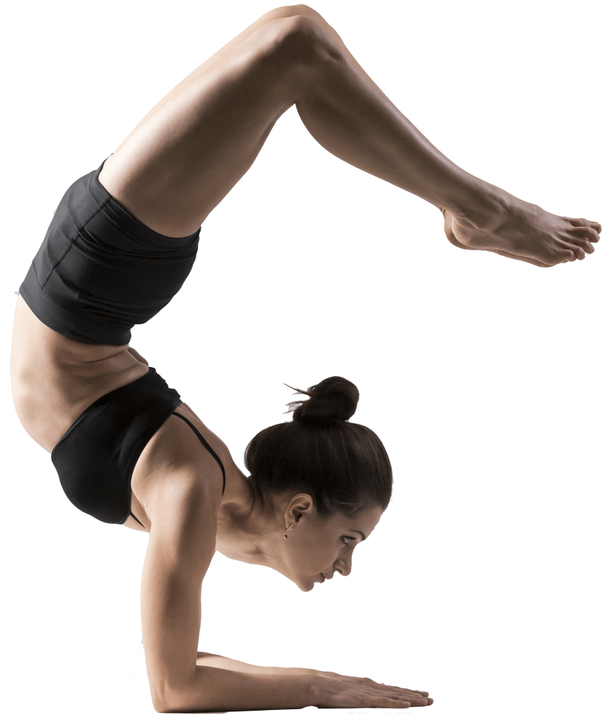 Yoga instructor performs asana pincha mayurasana