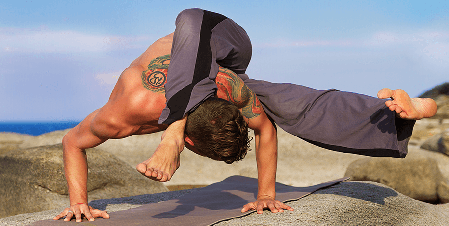 arm balance pose - tattoo man