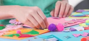 Little boy making artworks on art lesson at kindergarten